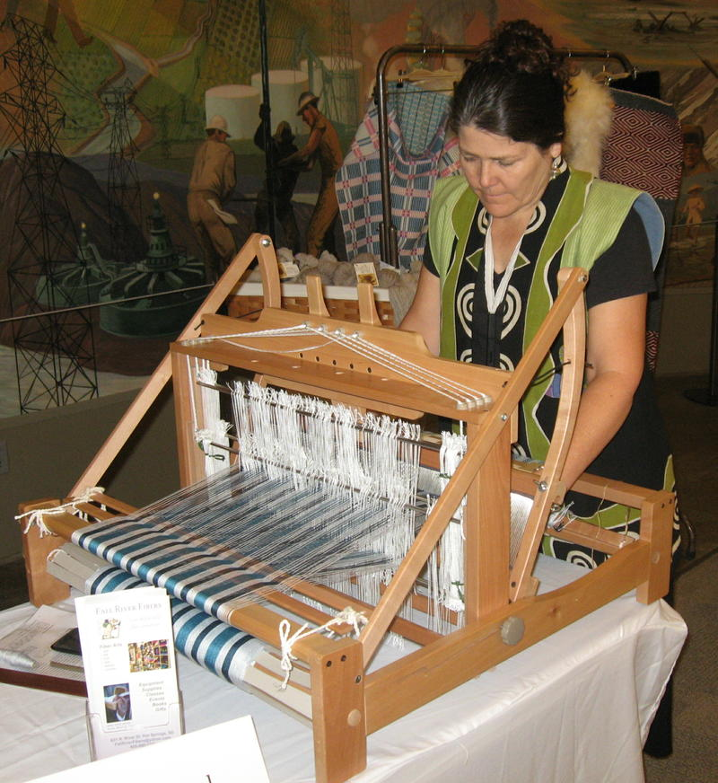 Terry Slagel weaves cloth on a loom.