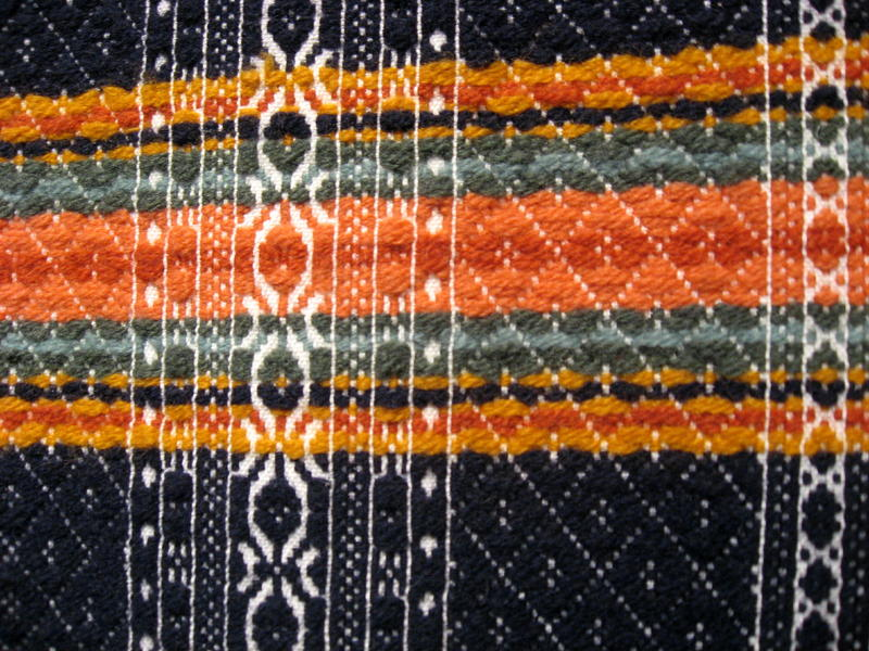 Closeup of the woven texture of the sleigh blanket.