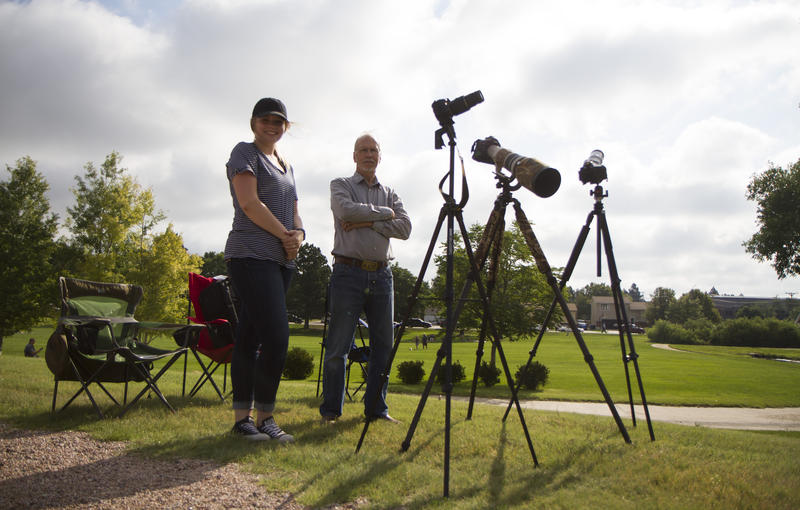 Ted Ayers from the Black Hills Photo Club and Drew Stevens set up cameras an telescopes.