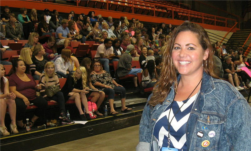 Nancy Yearing has been a producer with American Idol for nine years. She stands in front of contestants and their supporters in Rapid City.