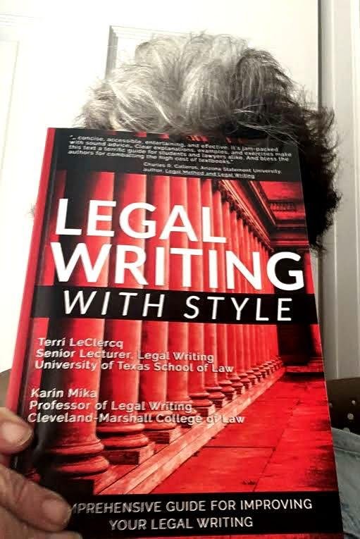 Terri Leclercq hides behind the book she coauthored. Leclercq is a nationlly recognized expert on legal writing and retired senior lecturer at the University of Texas School of Law.