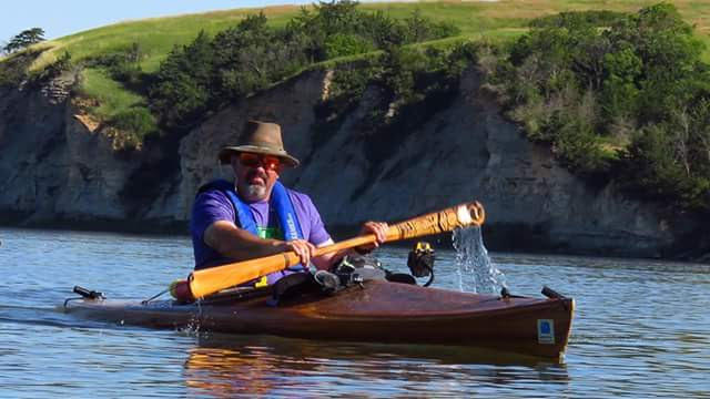 Roger Foote paddles in a kayak