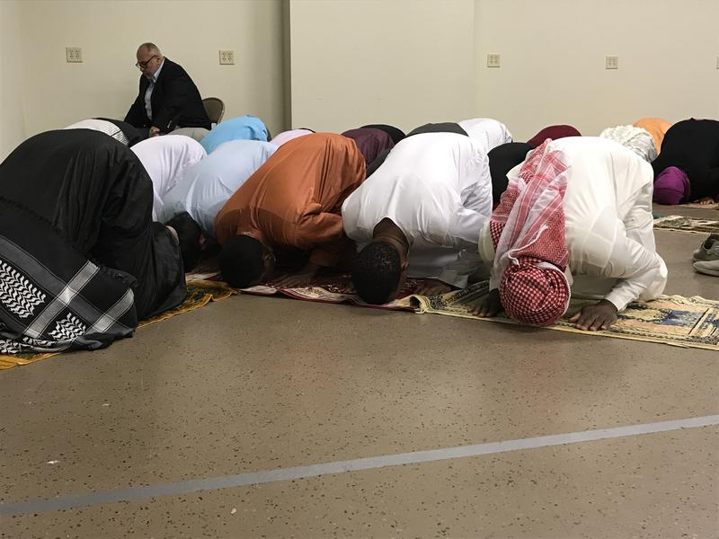 Men and women from the Sioux Falls Muslim community pray at Augustana Lutheran Church in Sioux Falls