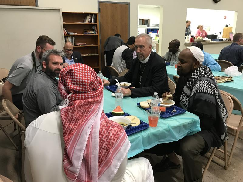 Bishop David Zellmer Eats with members of the Sioux Falls Muslim and Lutheran community