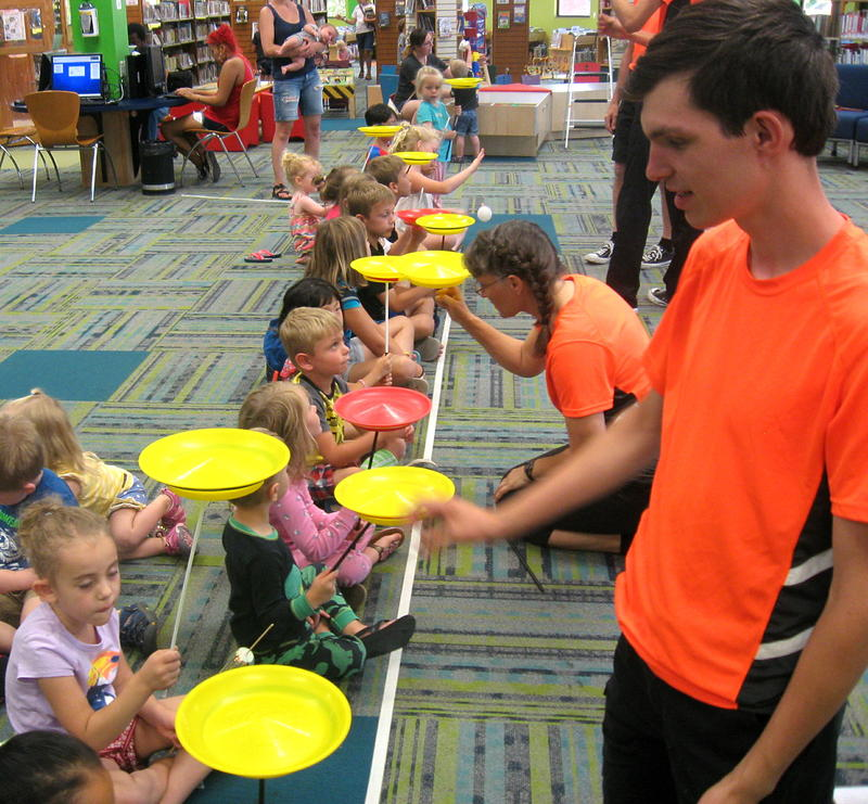 Matthew Hanson also helps children spin plates in a show that included hands-on participation from the kids in the audience.