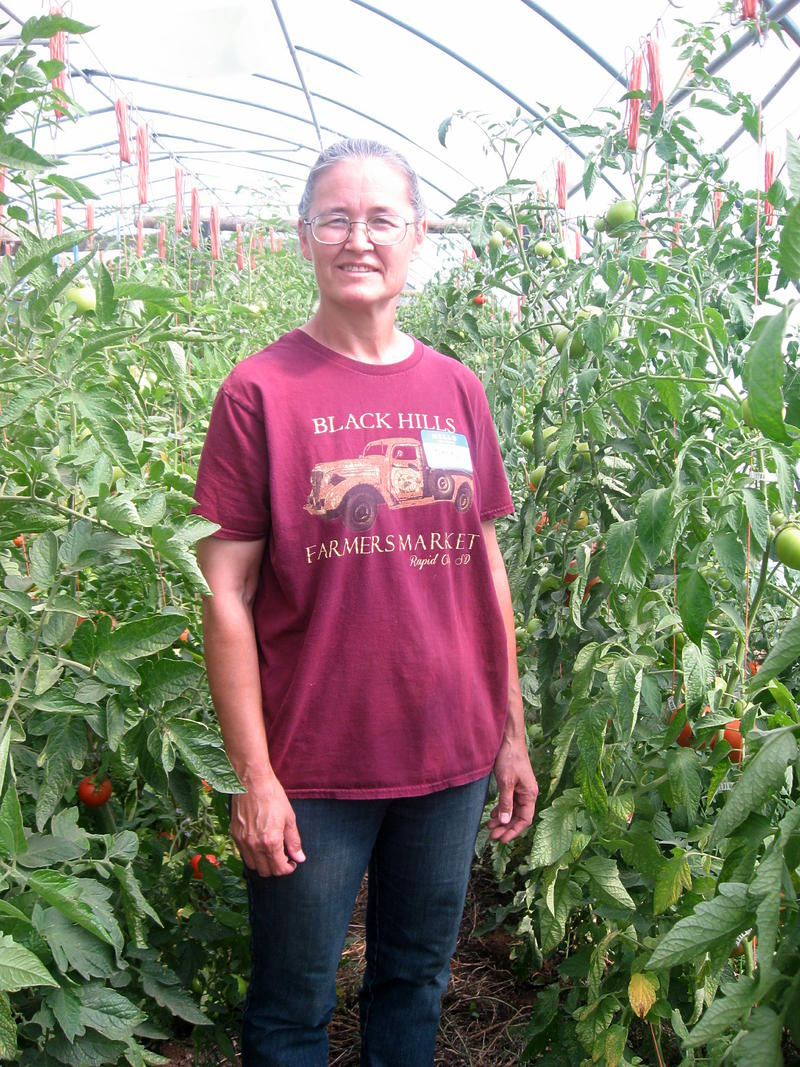 Becky Kirby in her greenhouse.