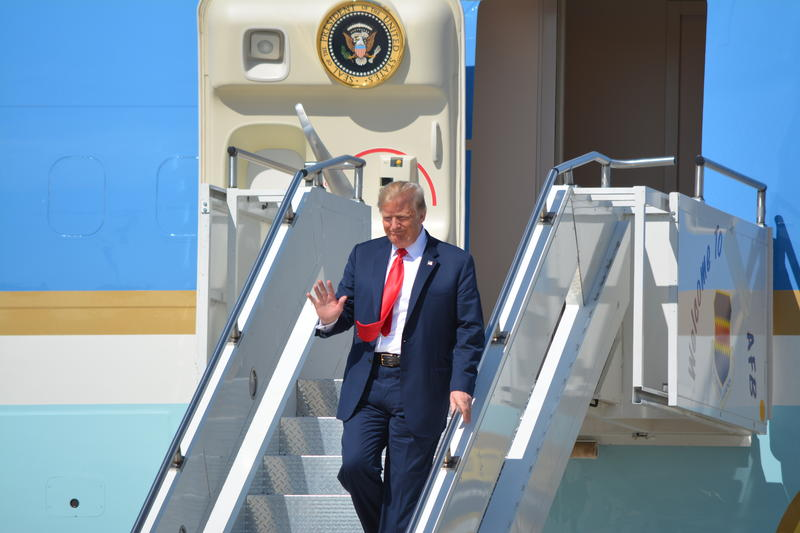 President Trump waves to the gathering of supporters at the Sioux Falls Airport.