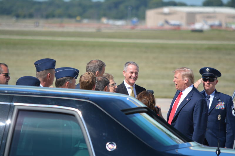 Governor Dennis Daugaard and others greet the president upon arrival.
