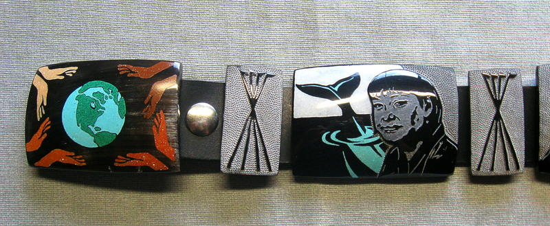 The belt buckle and Susie Silook, with tipi tiles between them.