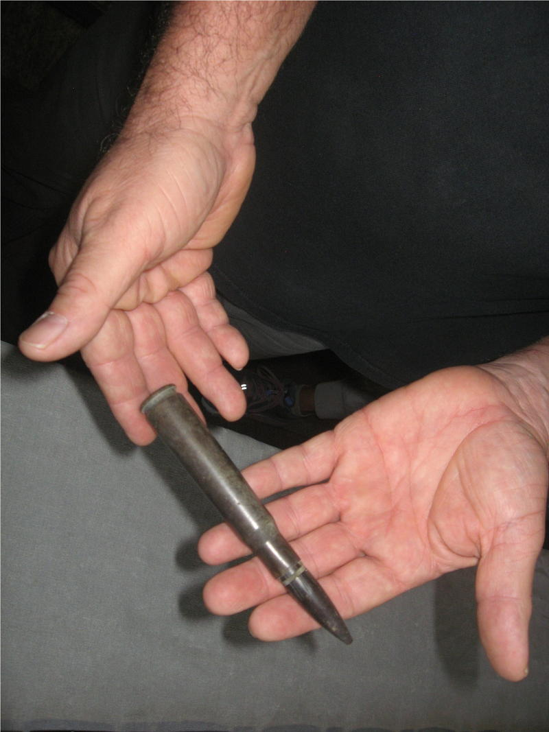Kevin Pourier holds one of the bullets he has found on the old bombing range.