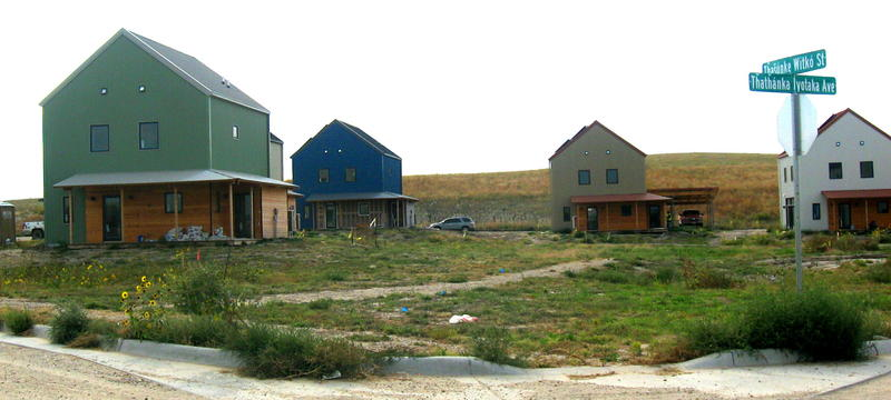 People are moving into these houses, built facing east around a central piece of land that residents will use in the way they together decide.