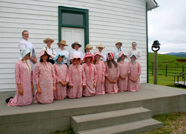 Young pioneers attend a historic one-room schoolhouse