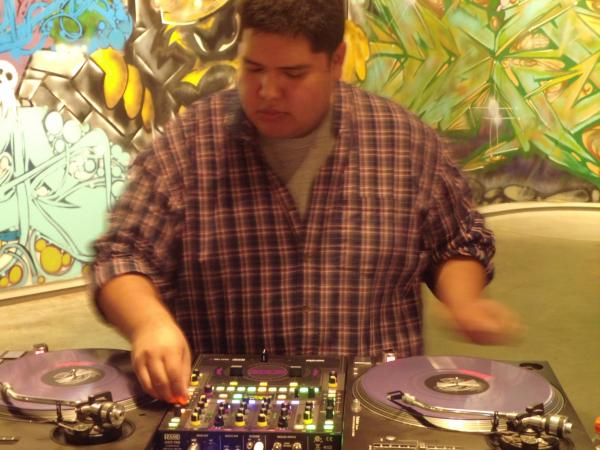 DJ MIcah spinning tunes at The Dahl Arts Center