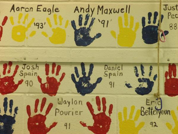 Members place their hand prints on selected walls in the Rapid City Club for Boys to show ownership.