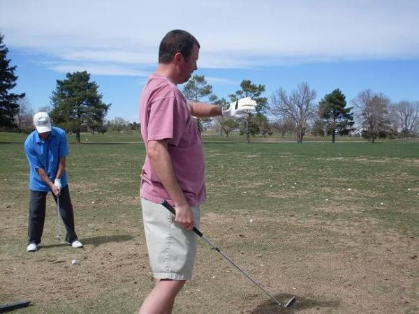 Seasoned golfer Joe Frey tests out the SensoGlove in Denver.