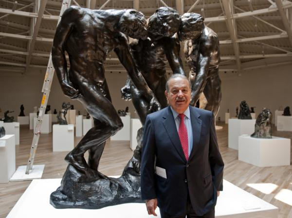 Carlos Slim invested more than $800 million in the Soumaya Museum, the second museum opened by the telecommunications mogul. Here, he stands with Auguste Rodin's <em>The Three Shades</em> on March 28, the eve of the opening.