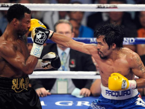 Manny Pacquiao hits Shane Mosley in the seventh round of their WBO welterweight title fight at the MGM Grand Garden Arena in Las Vegas on May 7. Pacquiao retained his title with a unanimous-decision victory.