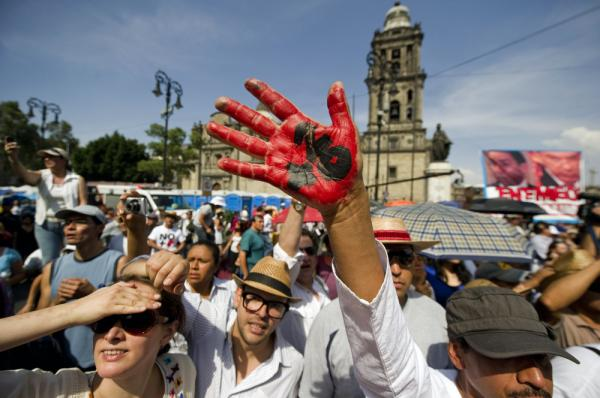 Demonstrators participate in a silent march to protest drug violence — which has left tens of thousands dead — and the military strategy that has failed to stop it, in Mexico City's Zocalo Square on Sunday.