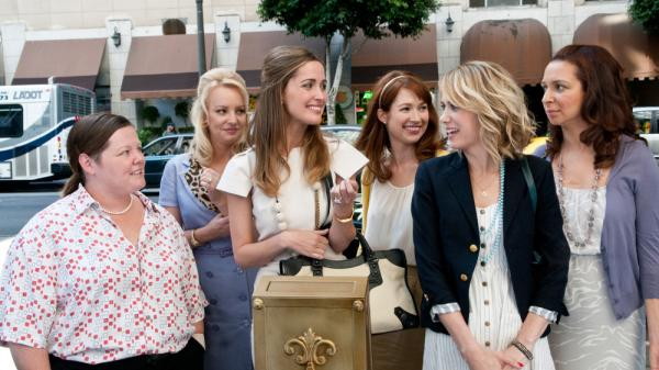"From left to right, Melissa McCarthy, Wendi McLendon-Covey, Rose Byrne, Ellie Kemper and Kristen Wiig plays bridesmaids in Maya Rudolph's wedding. David Edelstein says the movie is a ""terrific vehicle for Wiig."""