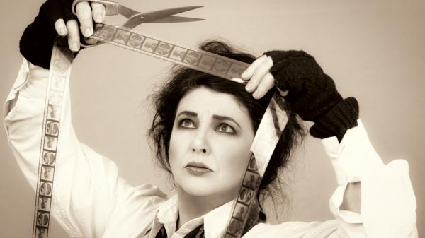 British singer Kate Bush acts out the title to her new album, <em>Director's Cut</em>.