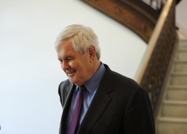Former house speaker Newt Gingrich walks down the stairs in the Russell Senate Office Building on Capitol Hill.