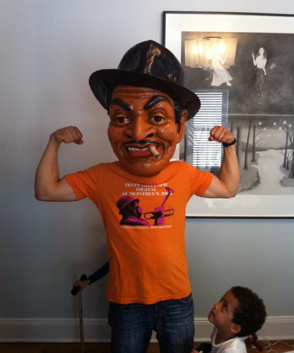 Yes, that's Jason Moran in a fan-made Fats Waller mask by artist Didier Civil. Moran's twins are pictured looking up at it to the side and behind him.