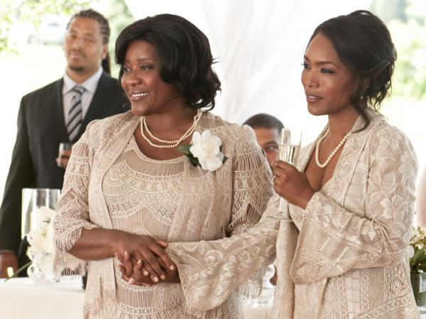 Loretta Devine (left) and Angela Bassett play dueling mothers in <em>Jumping The Broom</em>.
