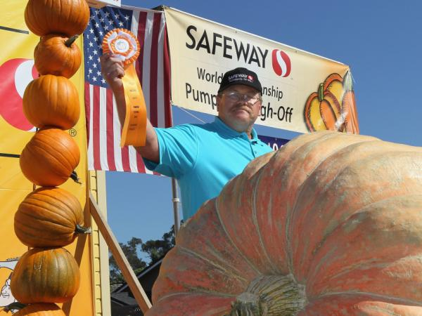 True to its small town feel, Half Moon Bay hosts the 37th Annual Safeway World Championship Pumpkin Weigh-Off. Here, Ron Root of Citrus Heights, CA celebrates winning first place — with his 1,535 pound pumpkin.