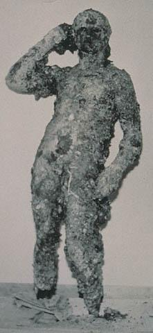 The Getty Bronze, covered in barnacles, as it appeared in 1964, when it was pulled out of the sea by fisherman off the coast of Fano, Italy.