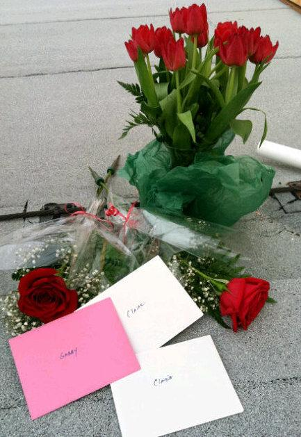 Flowers and cards left for his wife and daughters by Endeavour commander Mark Kelley.