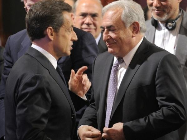 French President Nicolas Sarkozy (L) speaks to International Monetary Fund head Dominique Strauss-Kahn  at the Elysee Palace in Paris February 18, 2011. Strauss-Kahn has recently been accused of sexual assault in New York.