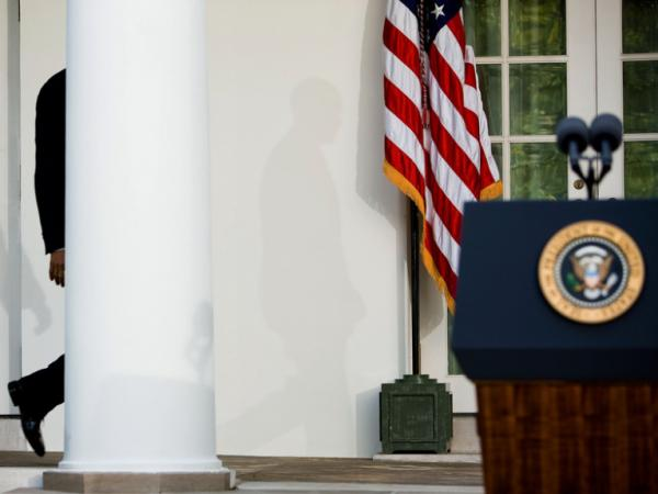 President Obama walks to the podium in the Rose Garden of the White House to deliver remarks on the Senate Finance Committee's vote to approve health insurance reform in October 2009.
