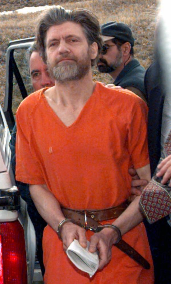 Unabomber Ted Kaczynski is escorted into the federal courthouse in Helena, Mont., Thursday, April 4, 1996.