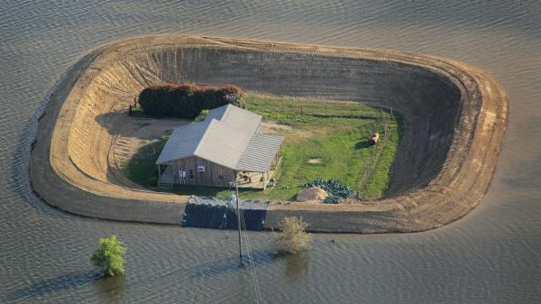 A levee protects a home surrounded by floodwater from the Yazoo River near Vicksburg, Mississippi on May 18, 2011.
