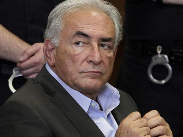 Former International Monetary Fund leader Dominique Strauss-Kahn listens to proceedings in his case in New York state Supreme Court on Thursday. The diplomat is one of several powerful white men accused of unsavory behavior in recent weeks.