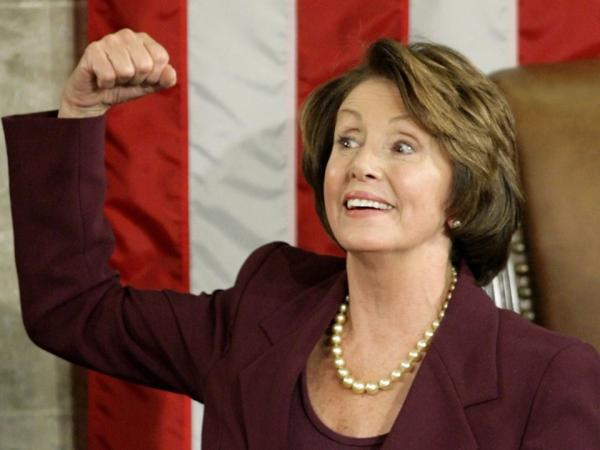 Pelosi flexes her muscles after being elected as the first female House speaker on Jan. 4, 2007.