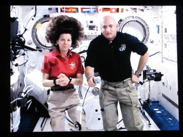 Endeavor shuttle commander Mark Kelly and Expedition 27 flight engineer Cady Coleman speak with Weekend Edition host Scott Simon (not pictured) from aboard the International Space Station.