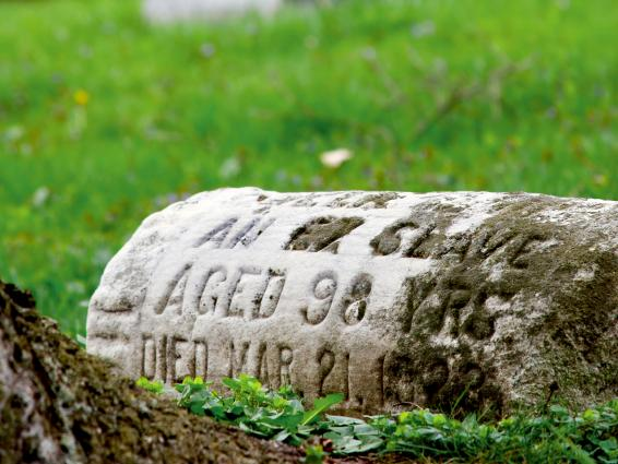 This 1800s tombstone of an ex-slave shows wear. Several organizations are fighting to reclaim African-American burial grounds that has been exhumed or turned into parking lots.