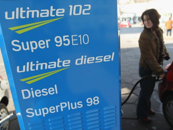 A woman fills her tank with E10 gasoline in Berlin on March 4. Delivery of the fuel, which is a blend of gasoline and 10 percent ethanol, has stopped because consumers are not buying enough of it.