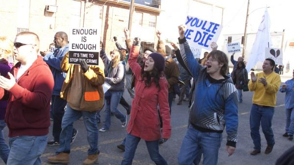 Annie (Lucia Micarelli) and Davis (Steve Zahn) march in the recreation of the Silence is Violence parade in Jan. 2007.