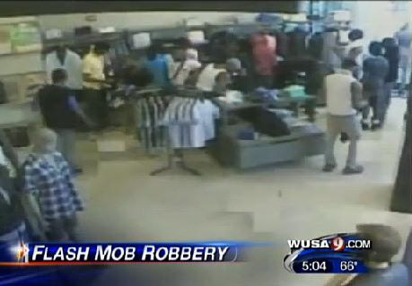 An image from a security camera at a clothing store in Washington, D.C., shows a flash mob robbery in April. Thousands of dollars' worth of merchandise was stolen, police said.