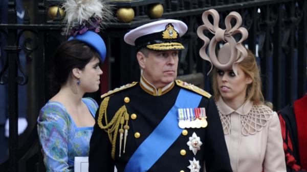 Prince Andrew, The Duke of York (C) and his daugthers Princesses Eugenie (L) and Beatrice  leave Westminster Abbey in London, after the wedding service, on April 29, 2011.