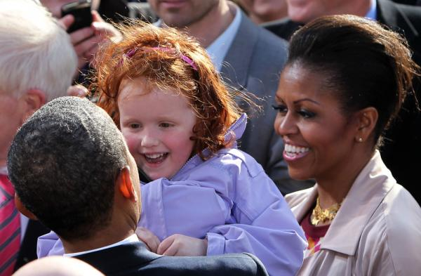 President Obama greets a young fan, with First Lady Michelle at his side, in Dublin, Ireland, May 23, 2011.