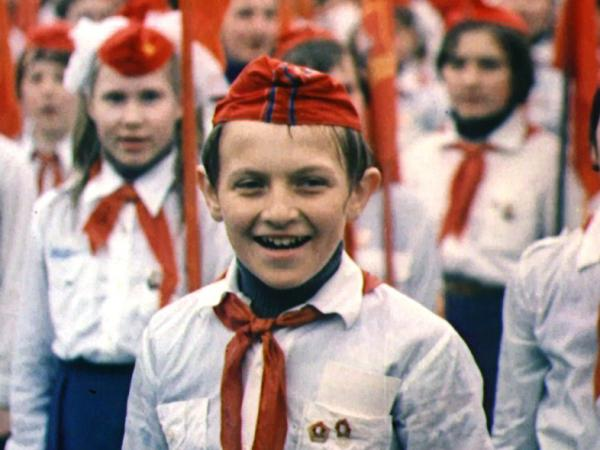 One of the children documented in <em>My Perestroika</em> at a celebration of the Soviet Youth.