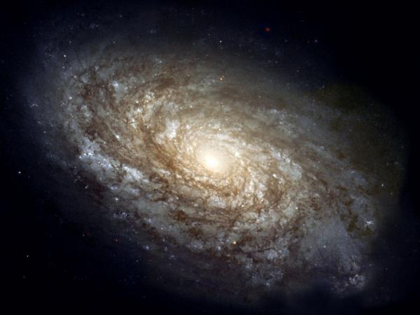 She found some more of what's out there. (Image: Hubble Space Telescope photo of spiral galaxy NGC 4414.)