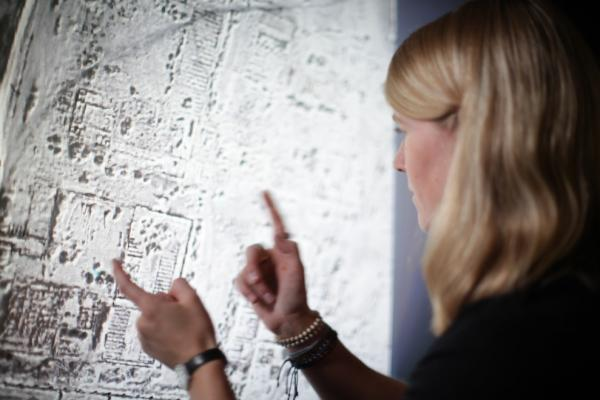Sarah Parcak examines satellite imagery of an Egyptian landscape.