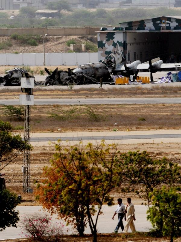 Aircraft wreckage is seen at the Mehran Pakistani naval air base a day after militants attacked it.