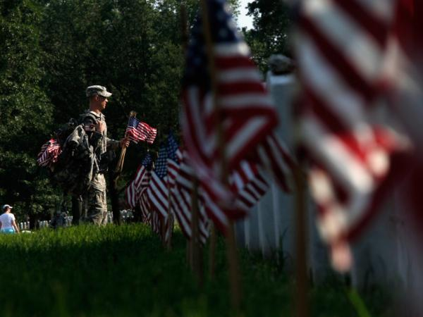 Members of the 3rd U.S. Infantry Regiment this week placed flags at the graves in Arlington National Cemetery in preparation for Memorial Day.