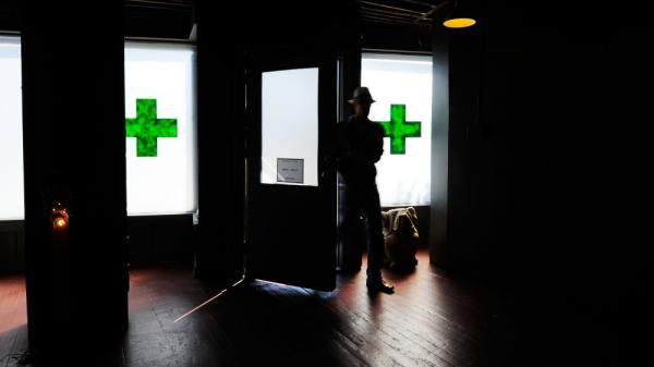 A client enters Sunset Junction medical marijuana dispensary on May 11, 2010 in Los Angeles, California.