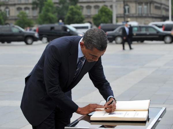 With his real hand in Europe, President Obama authorized the use of an autopen to sign into law the Patriot Act extension.
